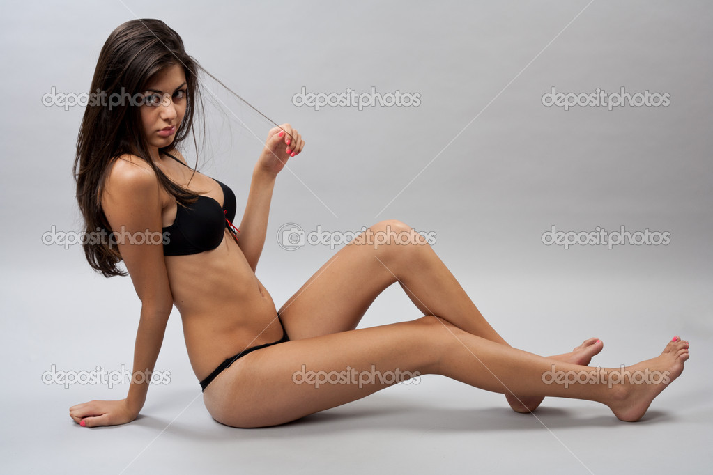 Beautiful bikini model in lingerie, studio shot series
