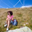 Stock Photo: Pretty woman in an alpine landscape