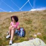 Pretty woman in an alpine landscape — Stock Photo