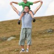 Father and son playing outdoor — Stock Photo