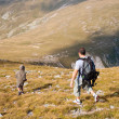 Father and son in the mountains — Stock Photo