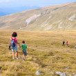 Stock Photo: Mother and son in mountains