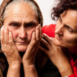 Consoling the elderly - Stock Photo