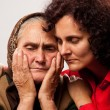 Consoling the elderly — Stock Photo