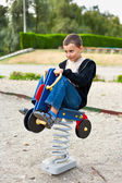 Cute kid playing in a park — Stock Photo