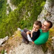 Father and son in mountains - Stock Photo