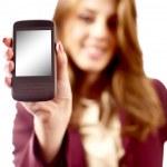 Businesswoman presenting PDA or smartphone — Stock Photo