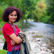 Woman outdoor near river — Stock Photo #3907985