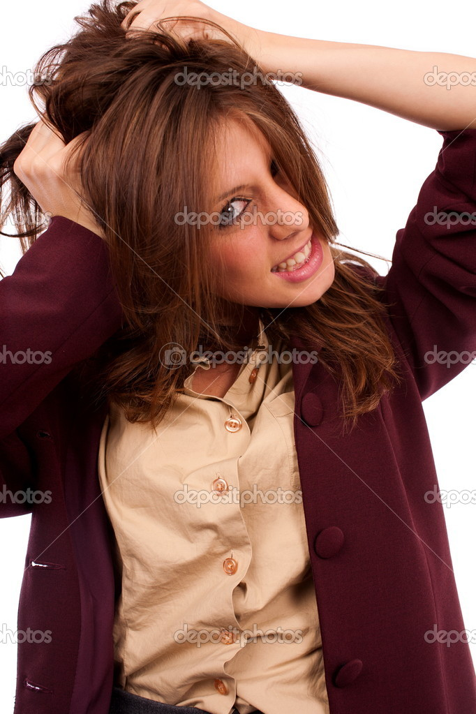 Portrait of a desperate young businesswoman pulling her hair — Stock Photo #3907880