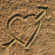 Love heart icon in the sand — Stock Photo
