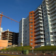 Construction crane and buildings — Stock Photo