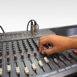 Sound mixer console and hand on white — Stock Photo #2937023