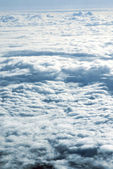 View from a plane above clouds — Stock Photo