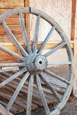 Old wooden wagon wheel — Stock Photo