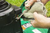 Checking oil on a lawn mower — Stock Photo