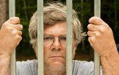 Man behind bars — Stock Photo