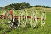 Hay rake in farmers field — Foto Stock