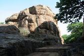 Rock beside Pavement — Stock Photo