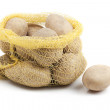 Sack with potatoes on white — Stock Photo
