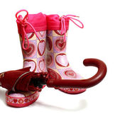 Pink rubber knee-boots and umbrella — Stock Photo