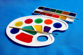Paints palette and brush for drawing — Stock Photo