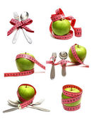Spoon fork and apple is strung by a ribbon for measuring diet — Stock Photo