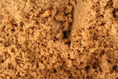 Brown sugar background — Stock Photo