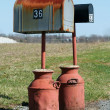 Two Mailboxes with milk jug bases — Stock Photo