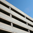 A tall parking deck against blue sky — Stock Photo