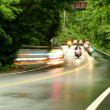 Police motorcycles speeding down a road — Stock Photo