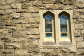 Stone wall with stained glass windows — Stock Photo