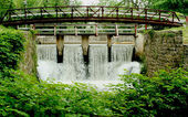 Bridge of a canal spillway — Stock Photo
