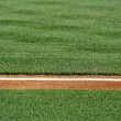 Stock Photo: Baseline on baseball field