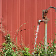 Stock Photo: Old water spigot with running water