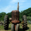 Old rusty farm tractor — Stock Photo
