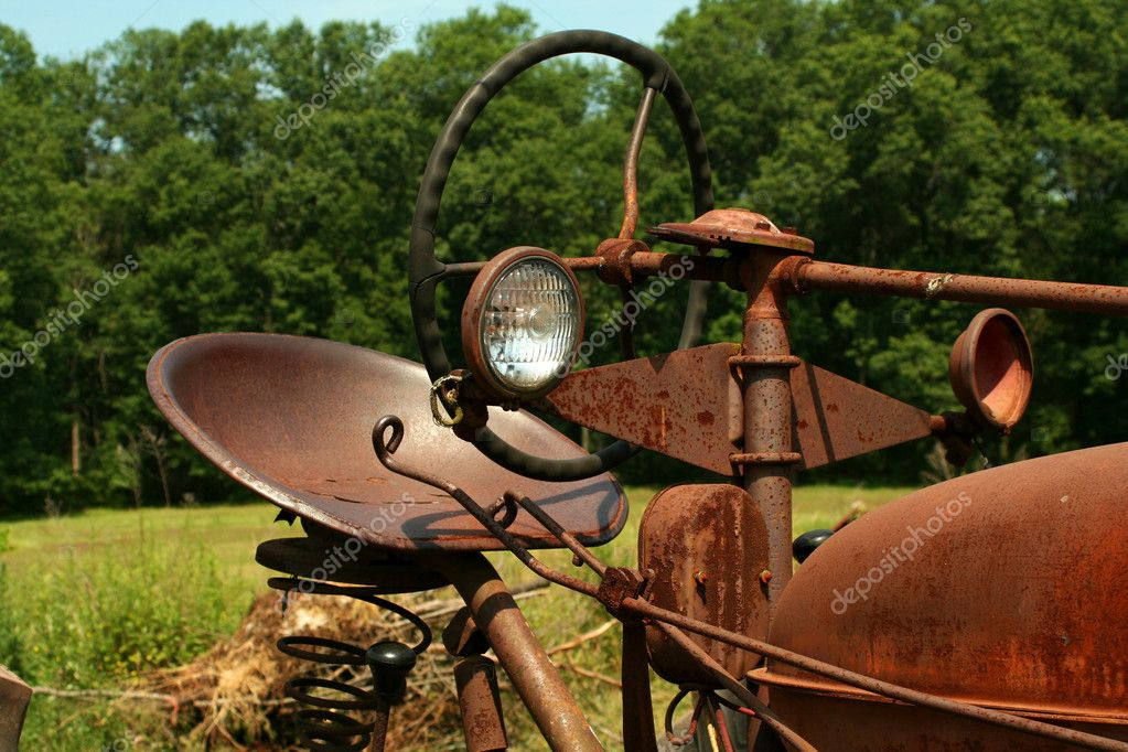 A Old rusty farm tractor — Stock Photo #3471079