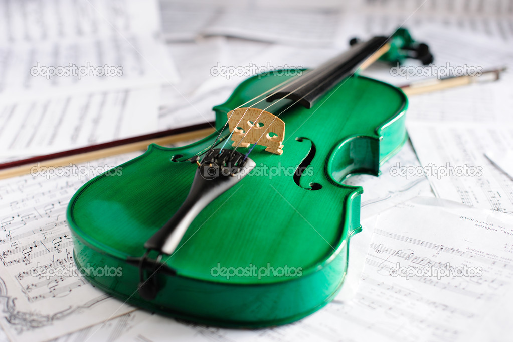 Green violin and musical score  Stock Photo #2814769