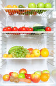 Fridge full of fruit and vegetables — Stock Photo