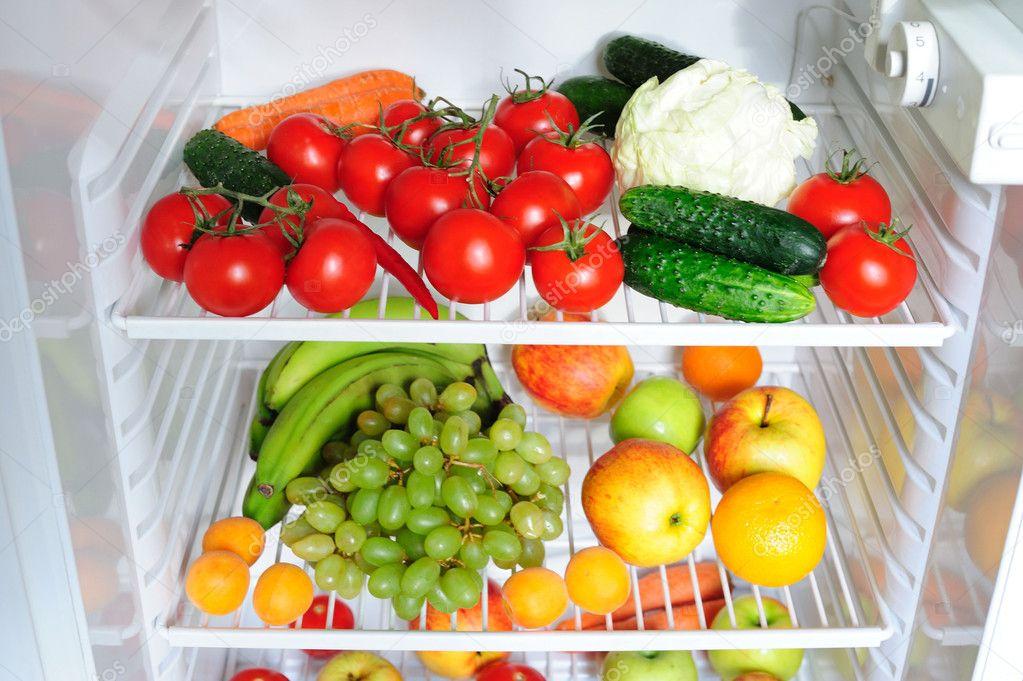 Fresh Fruit And Vegetables In The Fridge Stock Photo