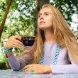 Girl pondering in summer cafe — Stock Photo #3805887