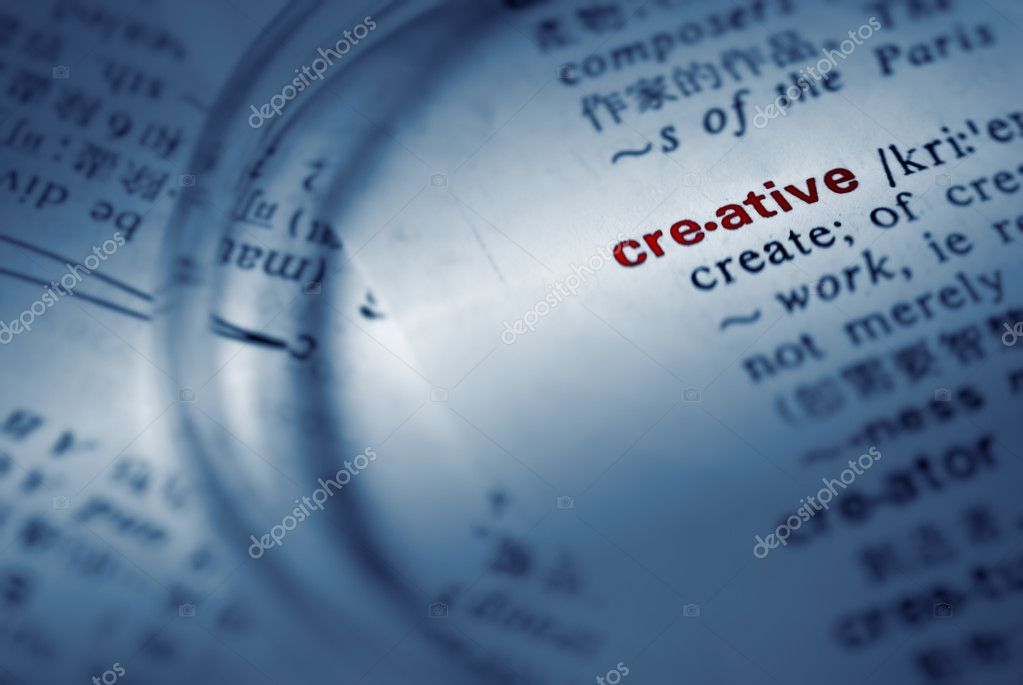Find creative definition from book by magnifier. — Stock Photo #2904907