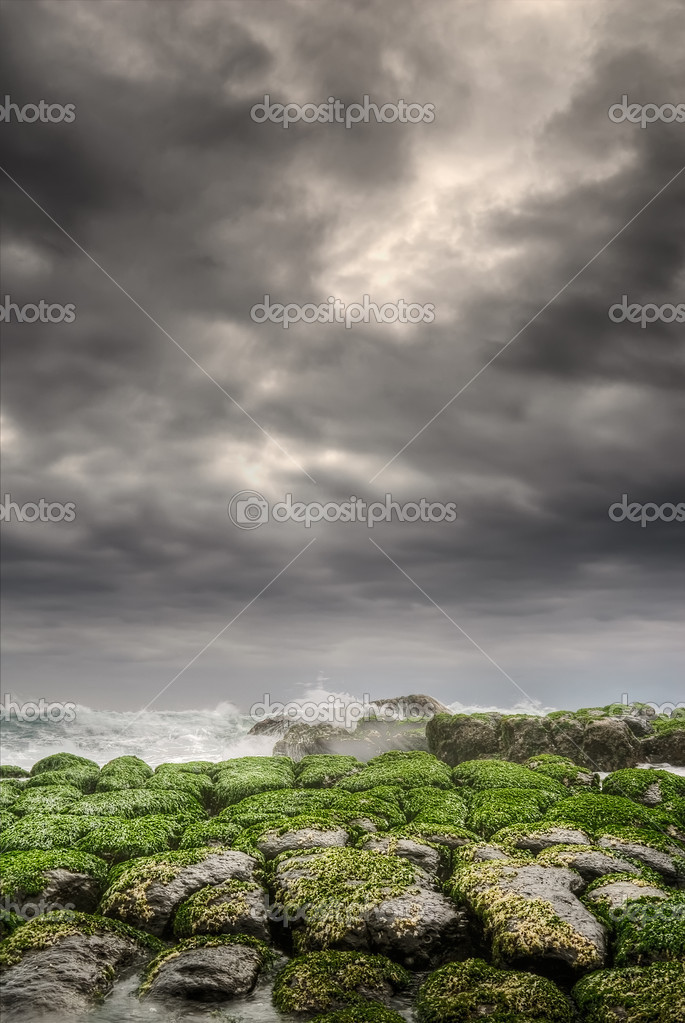 Green coastline under dramatic clouds in sky in morning. — Stock Photo #2945606