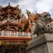 Color Chinese temple with lion stone — Stock Photo