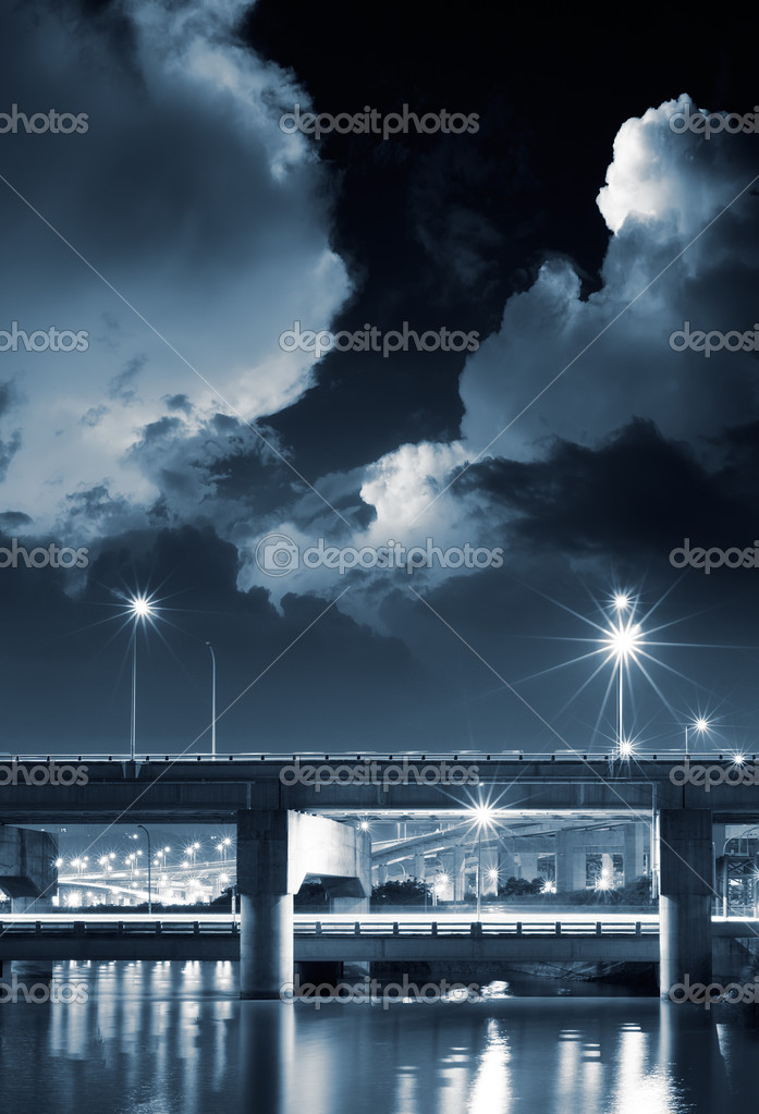 City night scene of bridge with dramtic clouds in sky. — Stock Photo #3332859