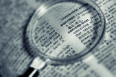 Focus on conception word with magnifier in book. — Stock Photo