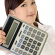 Business woman holding calculator — Stock Photo #3508219