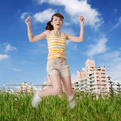 Happy girl jump in park — Stock Photo
