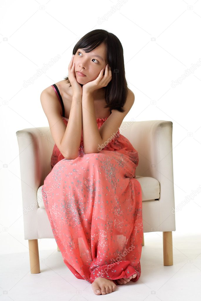 Asian beauty sit on chair and thinking on white background. — Stock Photo #3747547