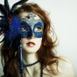 The beautiful young girl in a mask — Stockfoto