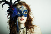 The beautiful young girl in a mask — Stock Photo